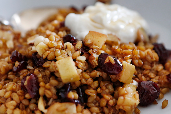 warm farro breakfast bowl with apples cranberries and hazelnuts is ...