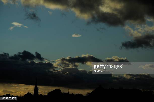 A warm glow is seen on the horizon as the sun sets in Bydgoszcz Poland on October 9 2017