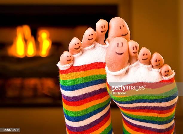 Warme glückliche Füße