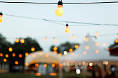 string wired with warming Light Bulbs hanging in the area of wedding events celebration in the night