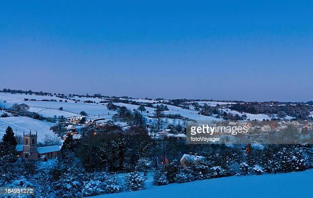 Warm lights glowing idyllic winter village