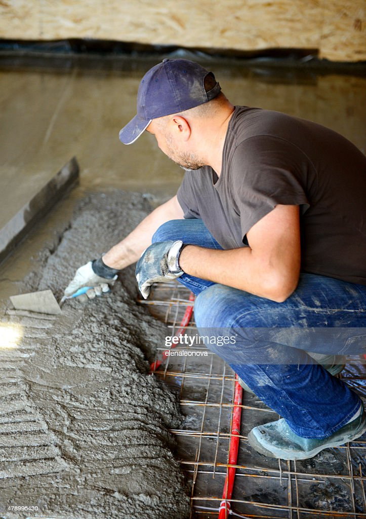 Warm water floorpouring concrete floor stock photo getty for Best temperature to pour concrete