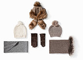 Warm winter knitted clothes - hat, scarf, gloves isolated on white background ( with clipping path)