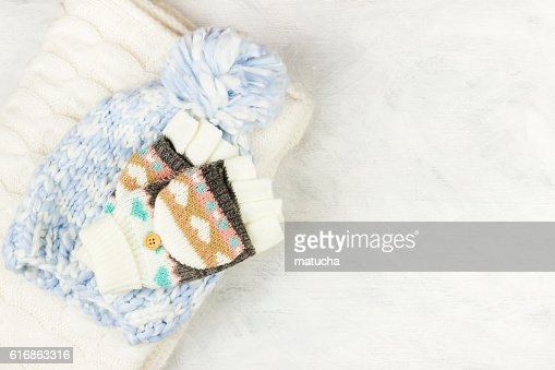 Warm woolen clothes on a white background : Stock Photo