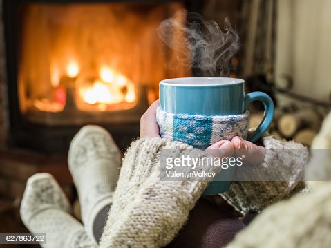 Warming and relaxing near fireplace. : Foto de stock