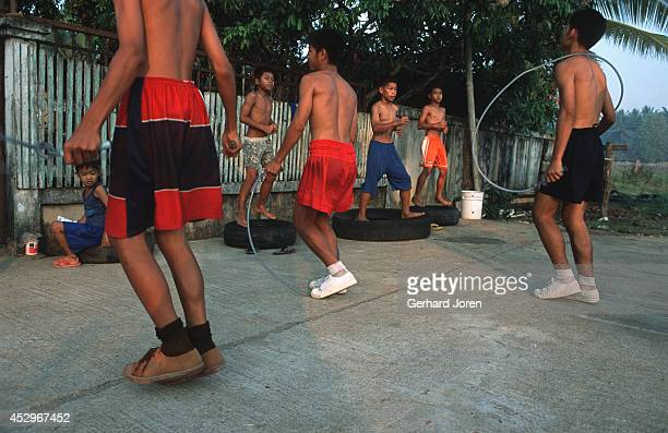 Warmingup exercises during a morning practice session at camp Sangsillee near Mae Sot The boxers undergo a rigorous physical training routine In the...