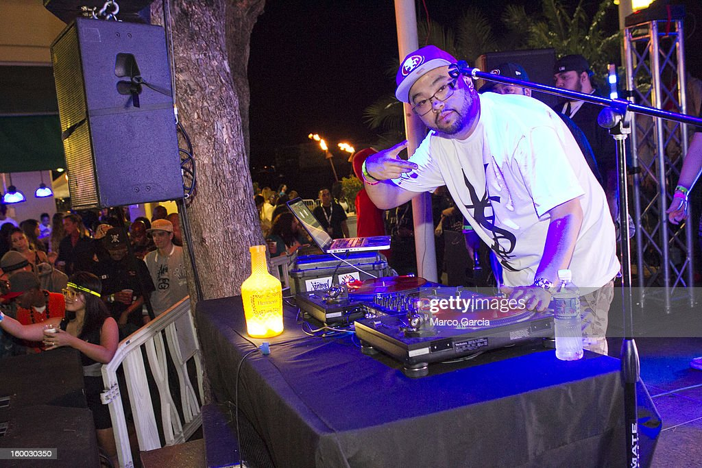 A DJ warms up the crowd before the start of the 2 Chainz concert at Aloha Tower Marketplace on January 24, 2013 in Honolulu, Hawaii.