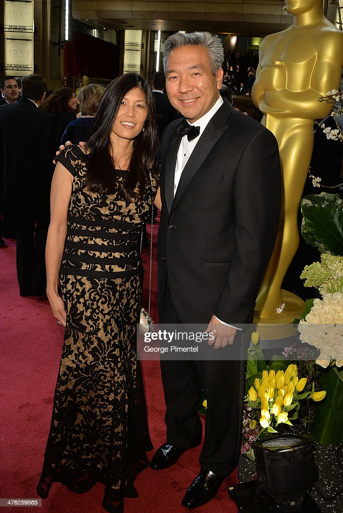 Warner Bros. CEO Kevin Tsujihara (R) and wife Sandy Tsujihara attends the Oscars held at Hollywood & Highland Center on March 2, 2014 in Hollywood, California.