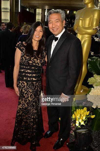 Warner Bros CEO Kevin Tsujihara and wife Sandy Tsujihara attends the Oscars held at Hollywood Highland Center on March 2 2014 in Hollywood California