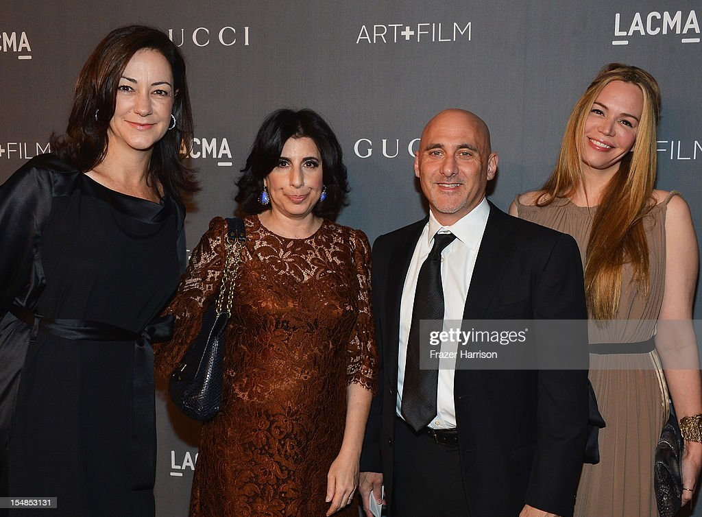 Warner Bros. Pictures Executive Vice President, International Marketing Lynne Frank, Warner Bros. Pictures President of Worldwide Marketing Sue Kroll, Warner Bros. Pictures Group President Jeff Robinov, and Nicole Robinov arrive at LACMA 2012 Art + Film Gala Honoring Ed Ruscha and Stanley Kubrick presented by Gucci at LACMA on October 27, 2012 in Los Angeles, California.