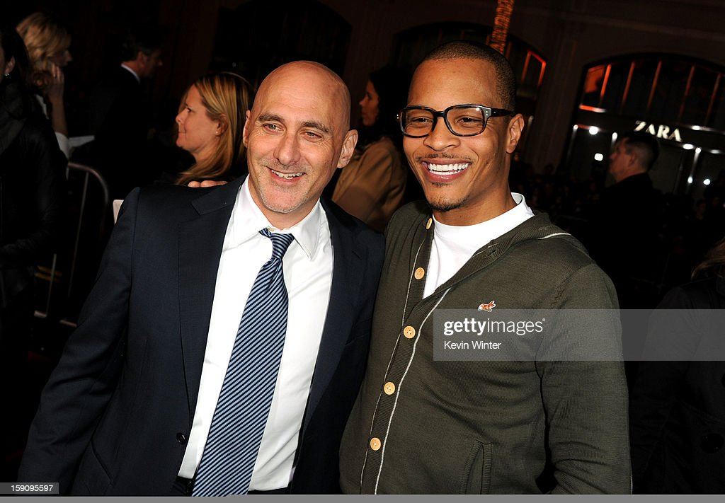 Warner Bros. Pictures Group President Jeff Robinov and rapper T.I. arrive at Warner Bros. Pictures' 'Gangster Squad' premiere at Grauman's Chinese Theatre on January 7, 2013 in Hollywood, California.