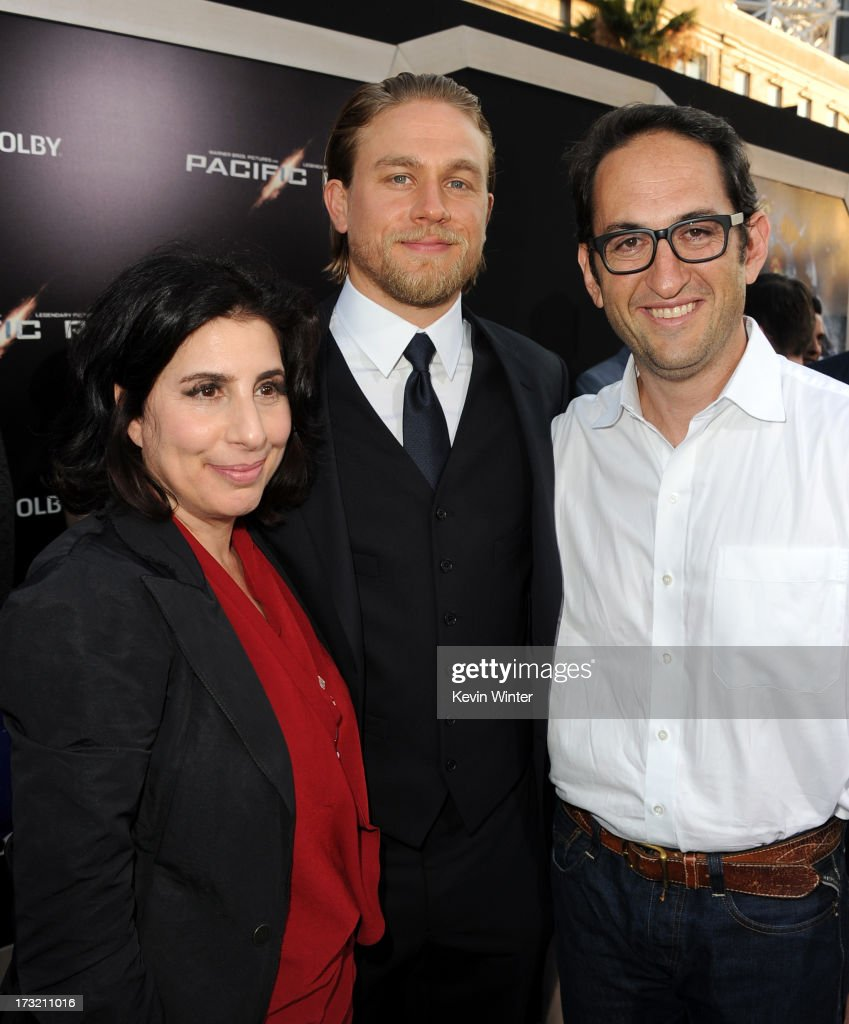 Warner Bros. Pictures President of Worldwide Marketing and International distribution Sue Kroll, actor Charlie Hunnam and Warner Bros. Pictures production president Greg Silverman arrive at the premiere of Warner Bros. Pictures' and Legendary Pictures' 'Pacific Rim' at Dolby Theatre on July 9, 2013 in Hollywood, California.