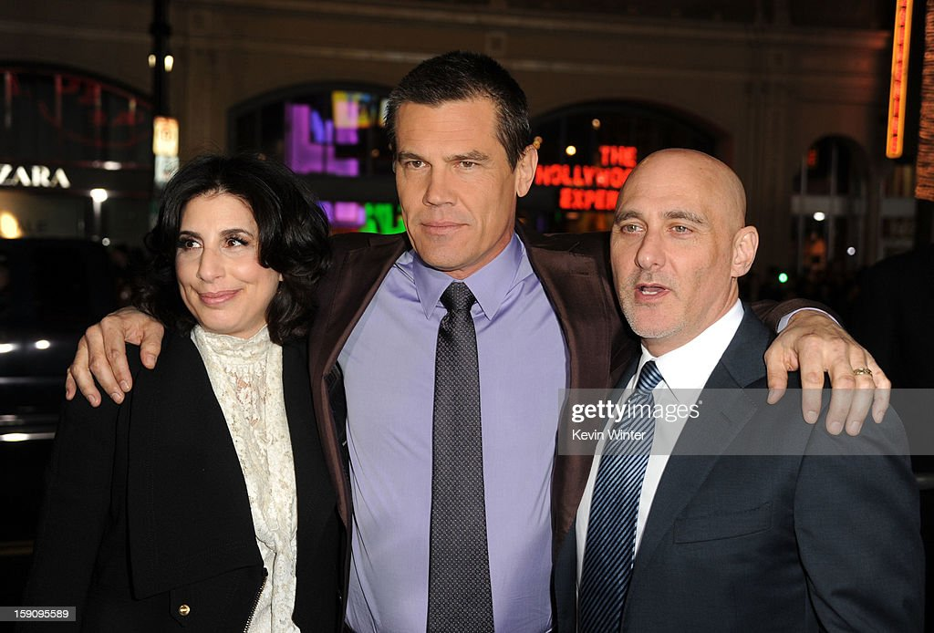 Warner Bros. Pictures Worldwide Marketing President Sue Kroll, actor Josh Brolin and Warner Bros. Pictures Group President Jeff Robinov arrive at Warner Bros. Pictures' 'Gangster Squad' premiere at Grauman's Chinese Theatre on January 7, 2013 in Hollywood, California.