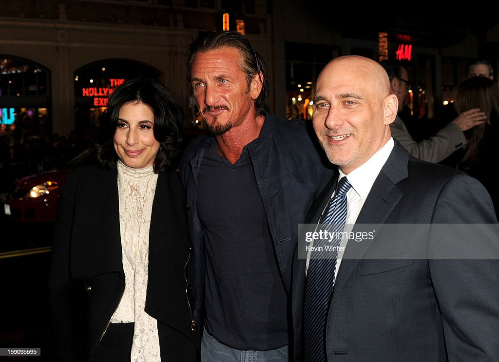 Warner Bros. Pictures Worldwide Marketing President Sue Kroll, actor Sean Penn and Warner Bros. Pictures Group President Jeff Robinov arrive at Warner Bros. Pictures' 'Gangster Squad' premiere at Grauman's Chinese Theatre on January 7, 2013 in Hollywood, California.