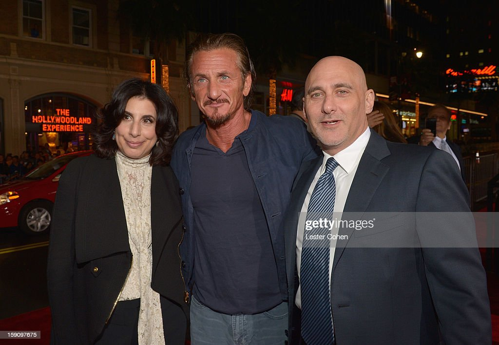 Warner Bros. Pictures Worldwide Marketing President Sue Kroll, actor Sean Penn and Warner Bros. Pictures Group President Jeff Robinov arrive at the 'Gangster Squad' premiere at Grauman's Chinese Theatre on January 7, 2013 in Hollywood, California.