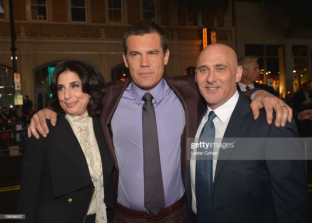 Warner Bros. Pictures Worldwide Marketing President Sue Kroll, actor Josh Brolin and Warner Bros. Pictures Group President Jeff Robinov arrive at the 'Gangster Squad' premiere at Grauman's Chinese Theatre on January 7, 2013 in Hollywood, California.