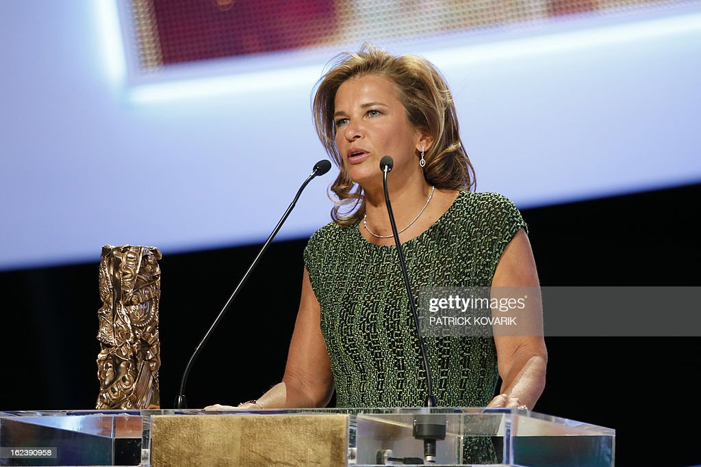 Warner Bros representative speaks on stage after receiving for US actor and director Ben Affleck the Best foreign film award for 'Argo' during the 38th Cesar Awards ceremony on February 22, 2013 at the Chatelet theatre in Paris.