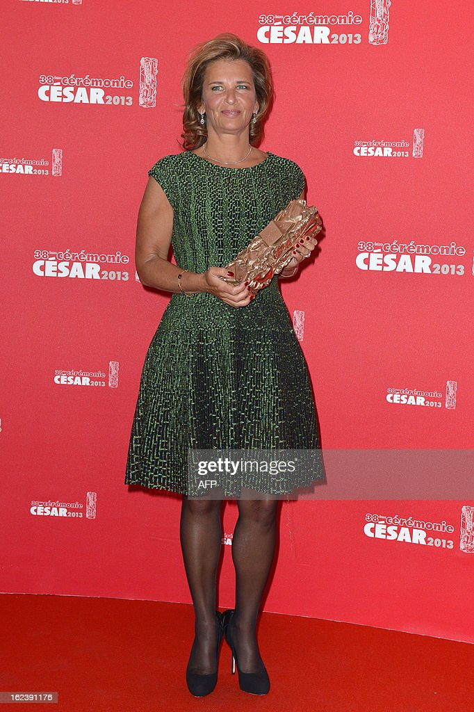 Warner Bros representative speaks on stage after receiving for US actor and director Ben Affleck the Best foreign film award for 'Argo' during a photocall at the 38th Cesar Awards ceremony on February 22, 2013 at the Chatelet theatre in Paris.