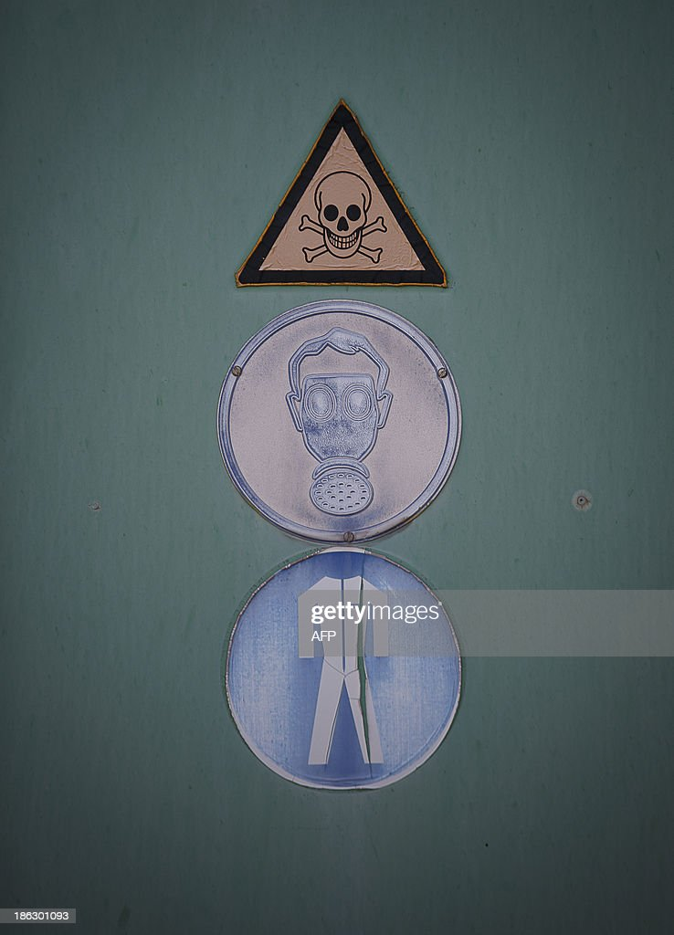 Warning sign are seen on a door during a demonstration in a chemical weapons disposal facility at GEKA (Gesellschaft zur Entsorgung von chemischen Kampfstoffen und Ruestungsaltlasten) in Munster, northern Germany, on October 30, 2013. The state-owned GEKA is a reference laboratory for the Organsation for the Prohibition of Chemical Weapons (OPCW).
