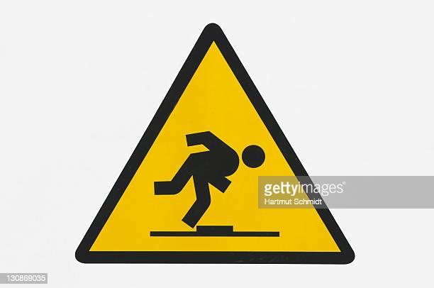Warning sign, danger of stumbling