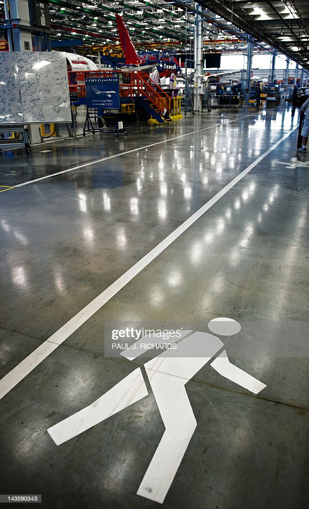 A warning sign for employees is seen on the floor at Boeing's new production facilities April 27, 2012, in North Charlston, South Carolina. Later in the day Boeing conducted 'roll-out' ceremonies for their first South Carolina made 787 Dreamliner aircraft. AFP PHOTO/Paul J. Richards