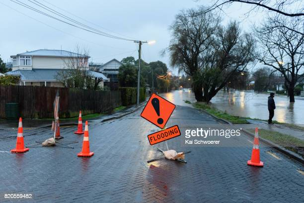 A warning sign is seen as rising waters cause flooding in Fifield Terrace in the suburb of Opawa on July 22 2017 in Christchurch New Zealand Heavy...