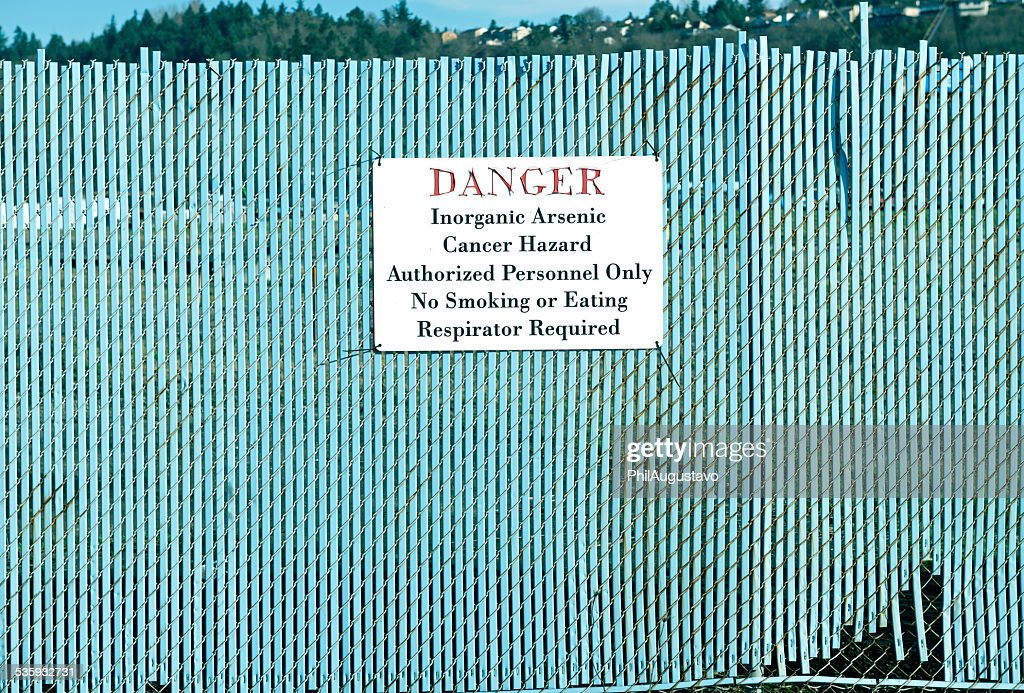 Warning sign on fence in industrial area of Tacoma WA : Stock Photo