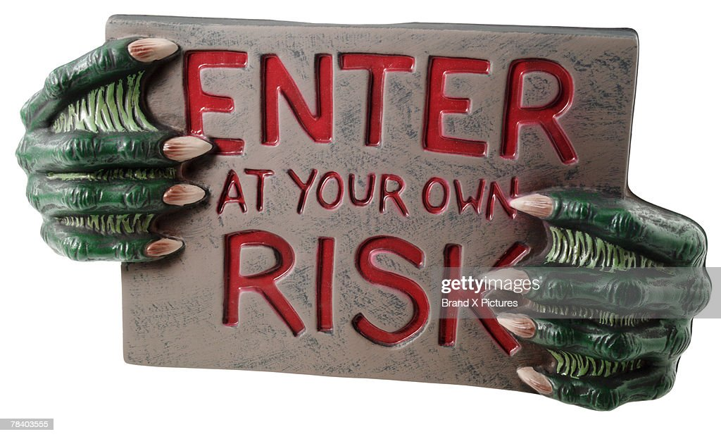 Warning sign with monster hands : Stock Photo