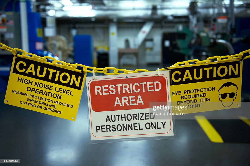Warning signs for employees are seen at Boeing's new production facilities April 27, 2012, in North Charlston, South Carolina. Boeing rolled-off it's first South Carolina made 787 Dreamliner aircraft here today. AFP PHOTO/Paul J. Richards