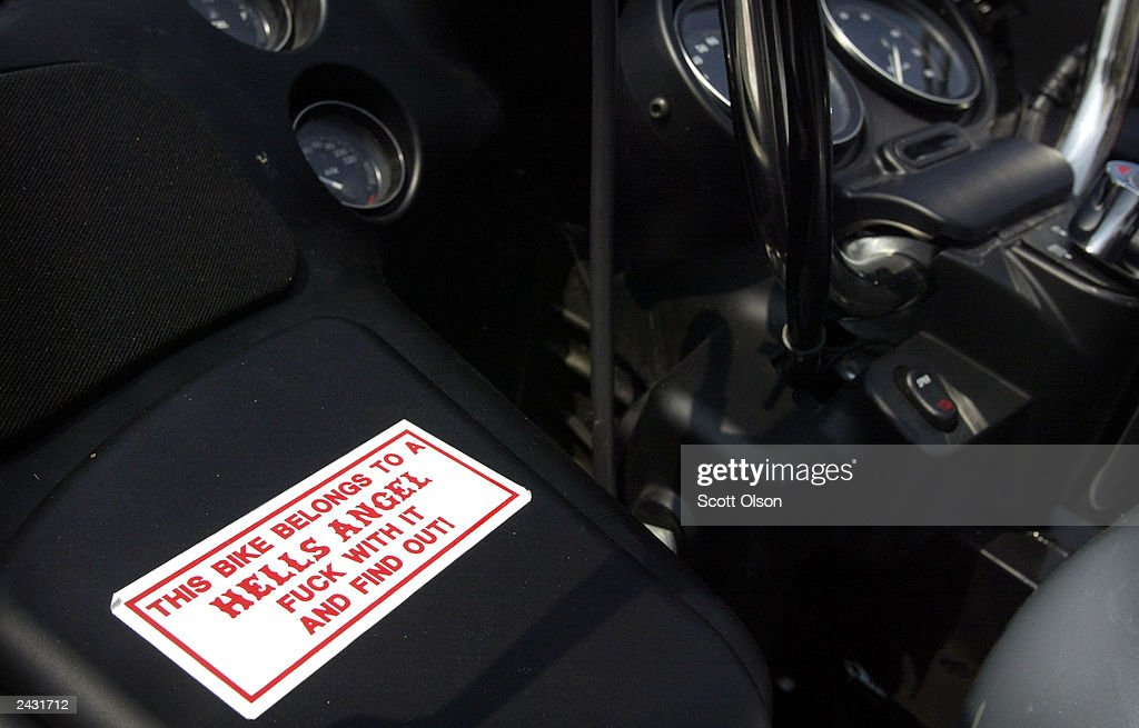 A warning sticker is shown glued to the fairing of a Hells Angels motorcycle parked at a club rally August 23, 2003 in Quincy, Illinois. The party was hosted by the Midwest Percenters motorcycle club in Quincy.