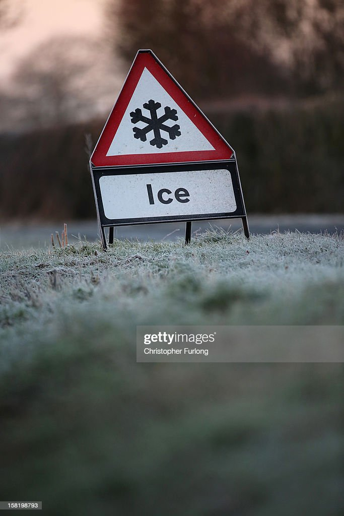 A warning triangle alerts drivers to an icy road on December 11, 2012 in Knutsford, England. Forecasters are warning that the UK could experience the coldest day of the year so far tomorrow, as temperatures could drop as low as -14C, bringing widespread ice, harsh frosts and freezing fog. Travel disruption is expected with warnings for heavy snow.