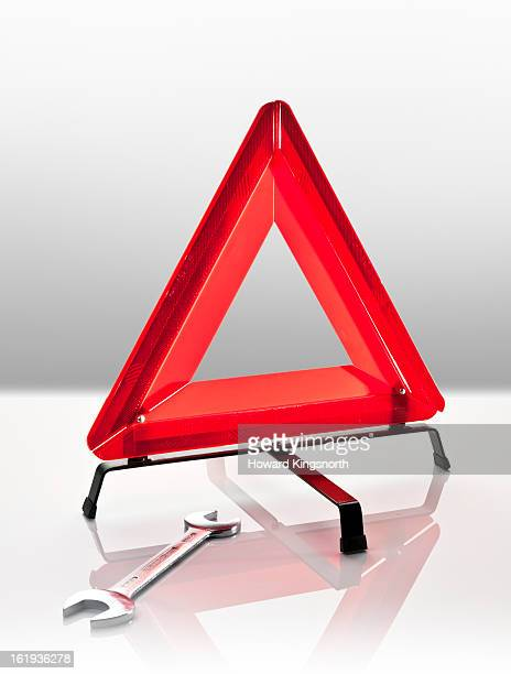 warning triangle and spanner