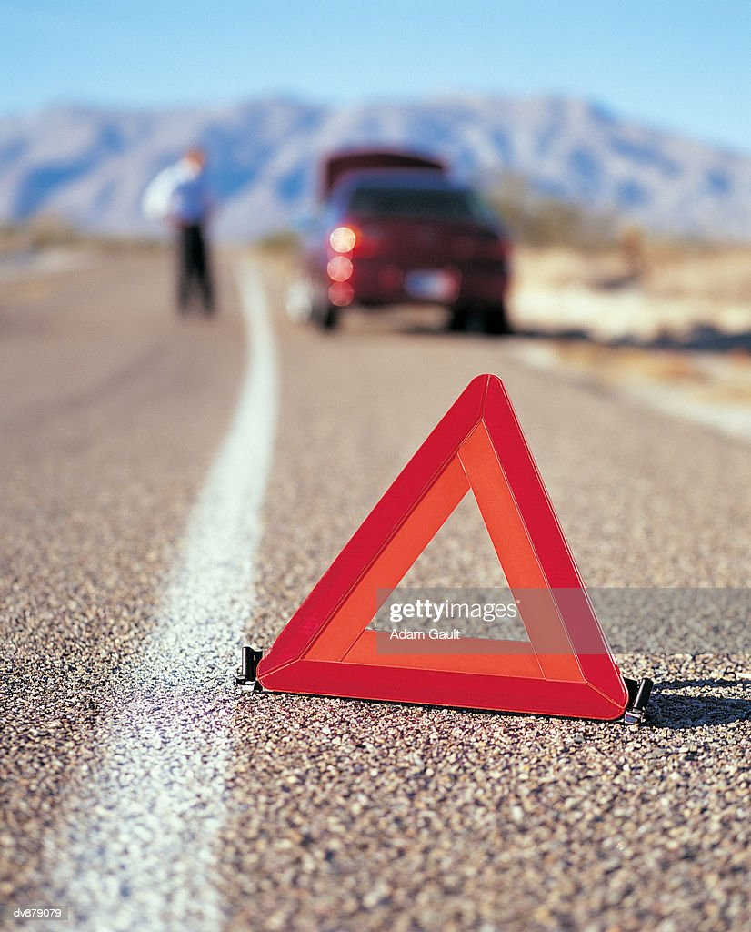 Warning Triangle in Front of Broken-Down Car on the Road : Stock Photo