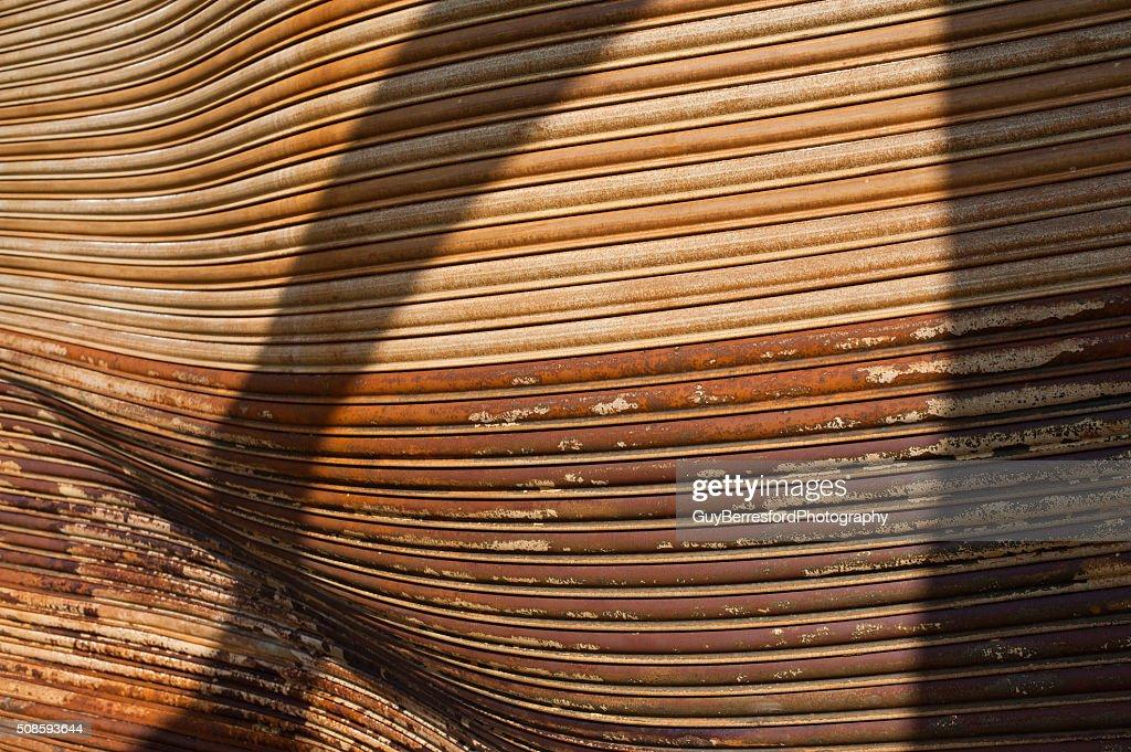 Warped burned rusted warehouse shutter doors : Stock Photo