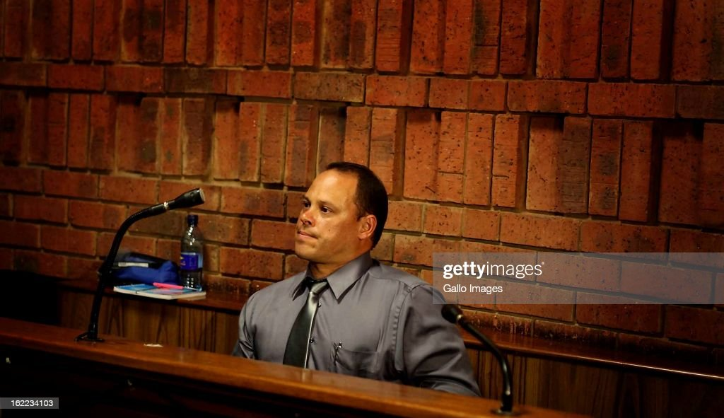 Warrant officer <a gi-track='captionPersonalityLinkClicked' href=/galleries/search?phrase=Hilton+Botha&family=editorial&specificpeople=10487140 ng-click='$event.stopPropagation()'>Hilton Botha</a> at the Pretoria magistrate's court on February 20, 2013, in Pretoria, South Africa. Oscar Pistorius is accused of murdering his girlfriend, Reeva Steenkamp on February 14, 2013.