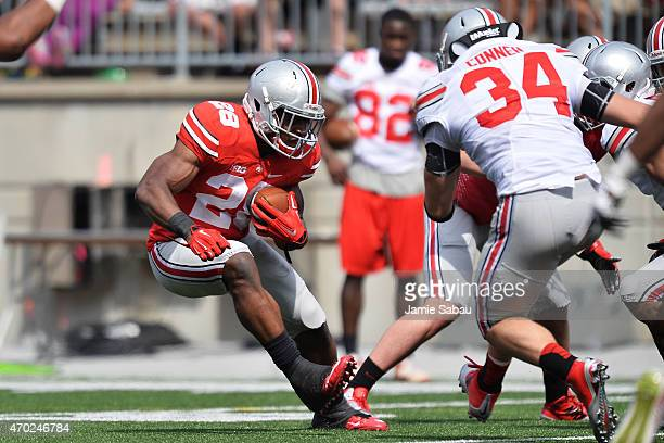 Warren Ball of the Ohio State Buckeyes Scarlet team cuts back against Nick Conner of the Ohio State Buckeyes Gray team in the third quarter of the...