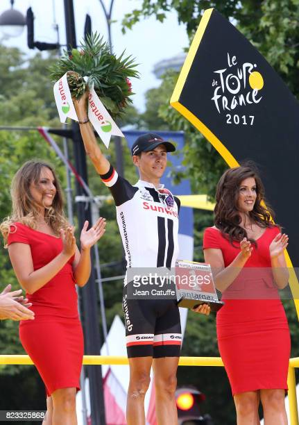 Warren Barguil of France and Team Sunweb receives the trophy for best fighter of the Tour during the trophy ceremony following stage 21 of the Tour...