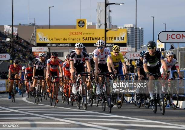 Warren Barguil of France leads the pack entering the first turn right after the start of the criterium main race at the Tour de France Saitama...