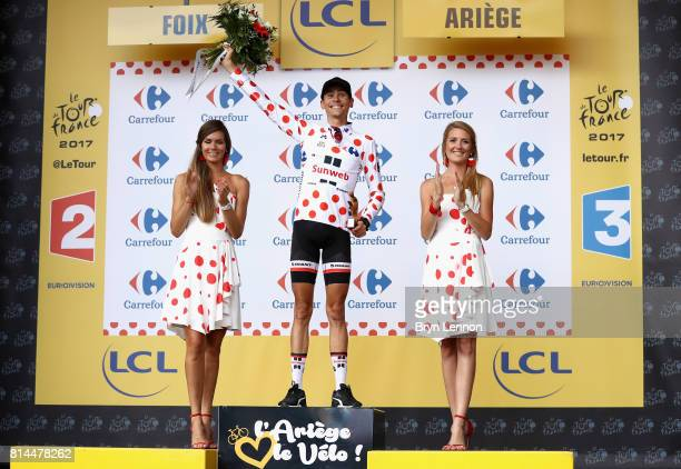Warren Barguil of France riding for Team Sunweb celebrates winning the stage and retaining the PolkaDot jersey after stage 13 of the Le Tour de...