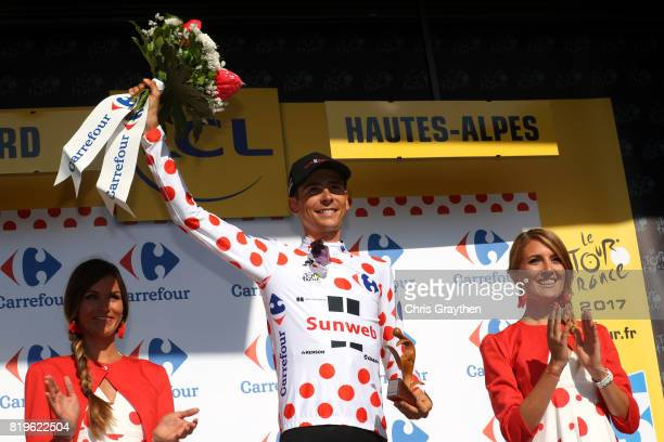 Warren Barguil of France riding for Team Sunweb in the king of the mountains jersey poses for a photo on the podium following stage 18 of the 2017 Le...
