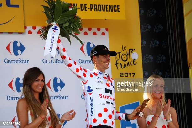 Warren Barguil of France riding for Team Sunweb is presented with the polka dot climbers jersey on the podium after stage nineteen of the 2017 Tour...
