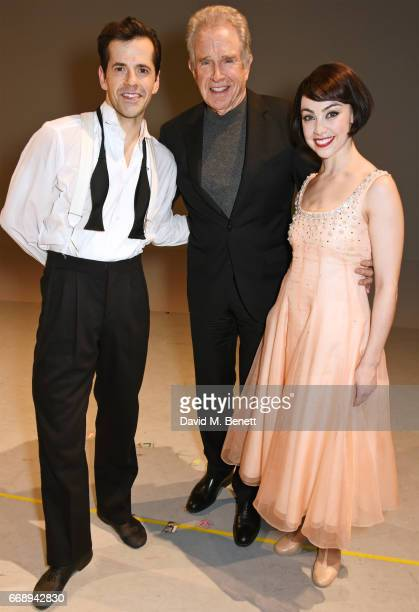 Warren Beatty poses backstage with cast members Robert Fairchild and Leanne Cope of the West End production of 'An American In Paris' at the Dominion...