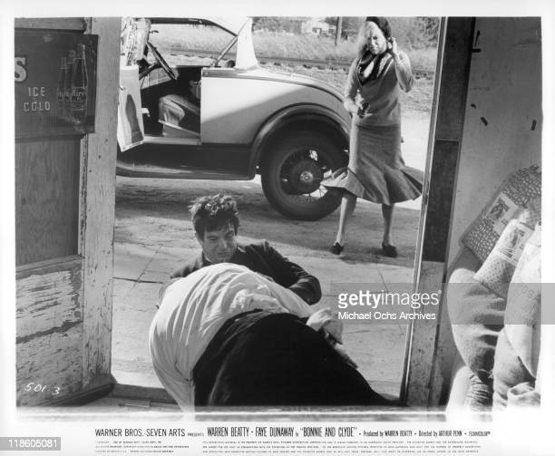 Warren Beatty struggles with James Stiver in a scene from the film 'Bonnie and Clyde' 1967