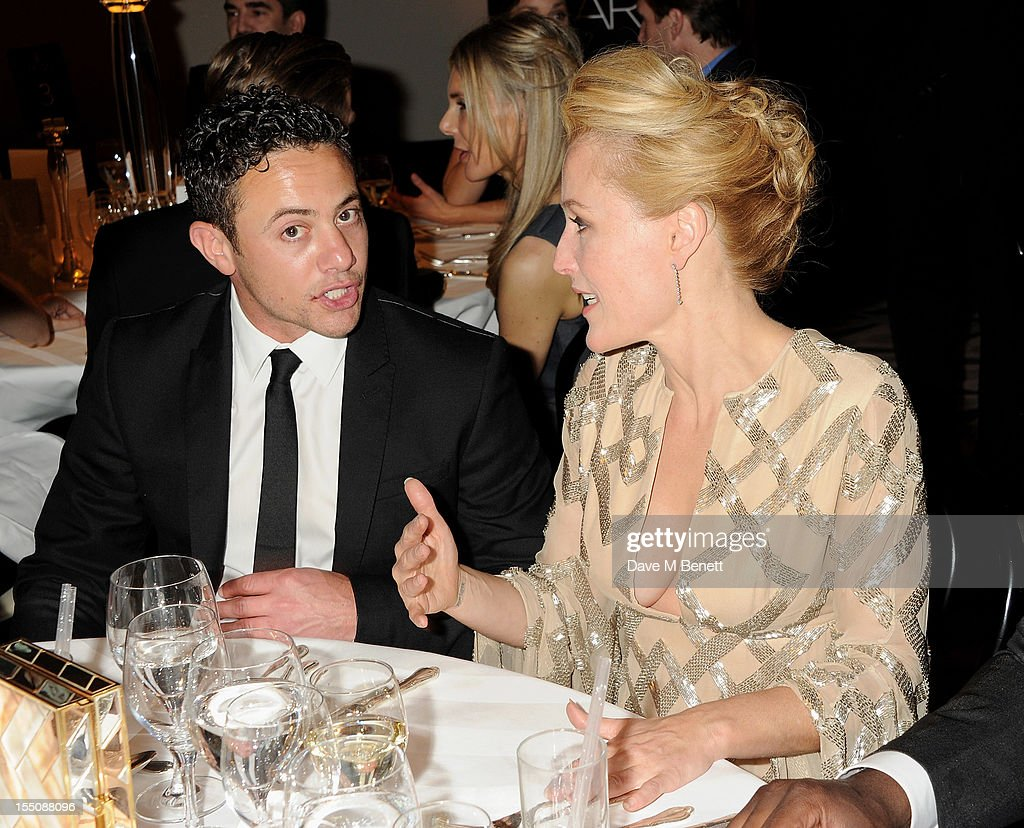 (MANDATORY CREDIT PHOTO BY DAVE M BENETT/GETTY IMAGES REQUIRED) Warren Brown (L) and Gillian Anderson attend the Harper's Bazaar Women of the Year Awards 2012, in association with Estee Lauder, Harrods and Tiffany & Co., at Claridge's Hotel on October 31, 2012 in London, England.