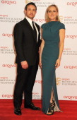 Warren Brown and Lesley Sharp pose in the press room at the Arqiva British Academy Television Awards 2013 at the Royal Festival Hall on May 12 2013...