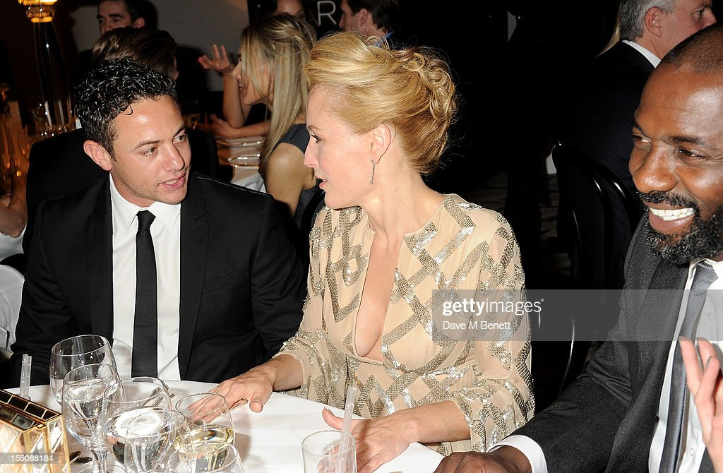 (MANDATORY CREDIT PHOTO BY DAVE M BENETT/GETTY IMAGES REQUIRED) (L to R) Warren Brown, Gillian Anderson and Idris Elba attend the Harper's Bazaar Women of the Year Awards 2012, in association with Estee Lauder, Harrods and Tiffany & Co., at Claridge's Hotel on October 31, 2012 in London, England.