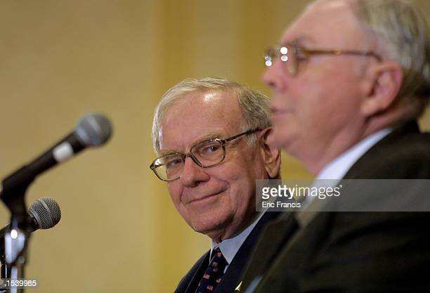 Warren Buffett and BerkshireHathaway partner Charlie Munger address members of the media May 5 2002 in Omaha Nebraska following the annual...