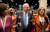 Warren Buffett Berkshire Hathaway Inc chairman and chief executive officer speaks to the media as he tours the exhibition floor during the Berkshire...