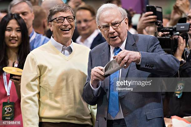 Warren Buffett Berkshire Hathaway Inc chairman and chief executive officer right talks with Bill Gates billionaire and cochair of the Bill and...