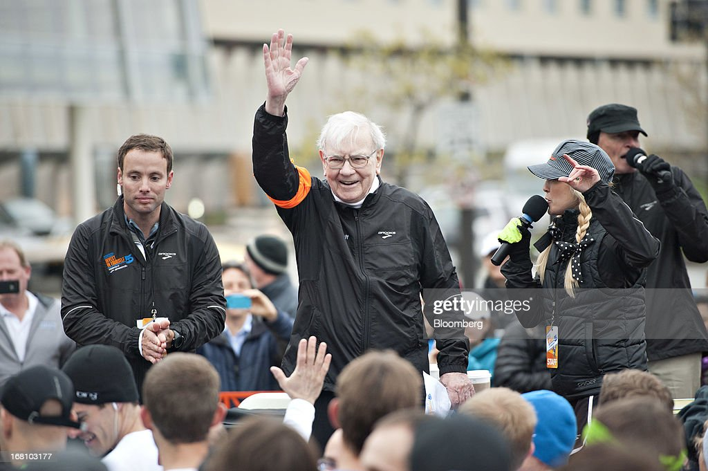 Warren Buffett, chairman and chief executive officer of Berkshire Hathaway, Inc., greets runners at the starting line of the 'Berkshire Hathaway Invest In Yourself 5K' race presented by Brooks Sports, Inc., a Berkshire company, in Omaha, Nebraska, U.S., on Sunday, May 5, 2013. Warren Buffett, the leader of Berkshire Hathaway since the 1960s, said the company's next chief executive officer will bolster the company's reputation as a source of stability in times of crisis. Photographer: Daniel Acker/Bloomberg via Getty Images